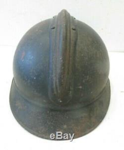 Beau casque ADRIAN de l' Artillerie modèle 1915, peinture bleu horizon, complet