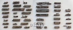 Collection complète de 44 locomotives, voitures, et wagons Médailler Franklin N